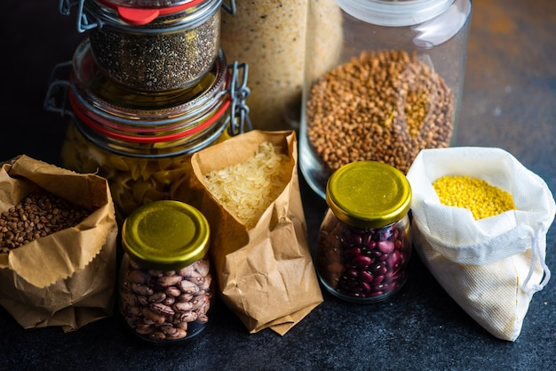 Food concept with assortment of survival product list as a buckwheat, rice, beans, pasta ad seeds
