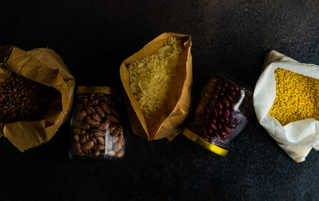 Food concept with assortment of survival product list as a buckwheat, rice, beans