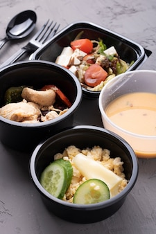 Food containers with stewed vegetables