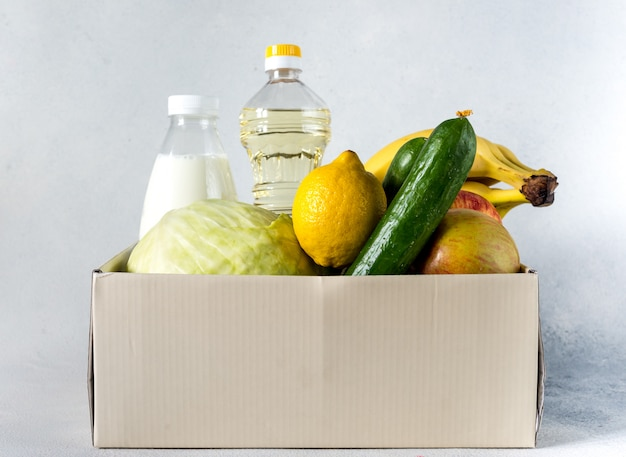 Food delivery box donation food donation concept. donation box with vegetables, fruits and other food for people