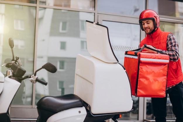 Food delivery boy delivering food on scooter