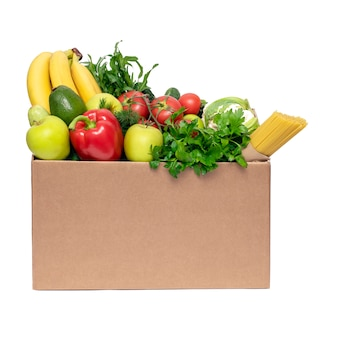 Food delivery concept.vegetables, fruits and food in a cardboard box on white