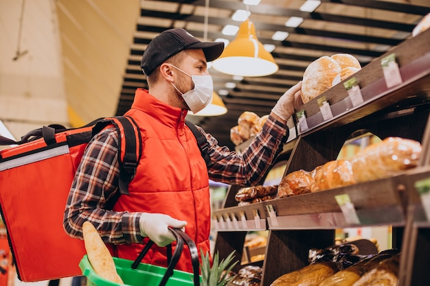 Food delivery man buying products at grocery store