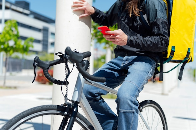 Food delivery man sitting on bicycle