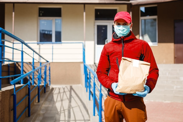 Food delivery man wearing medical mask. corona virus concept