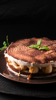 Food dessert concept homemade banoffee pie on black background