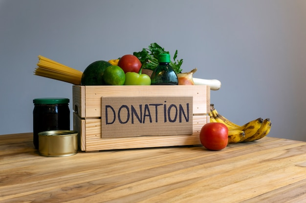 Food donation concept. donation box with vegetables, fruits and other food for donation
