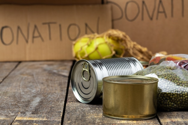 Food donations on the table. text donation. close up.