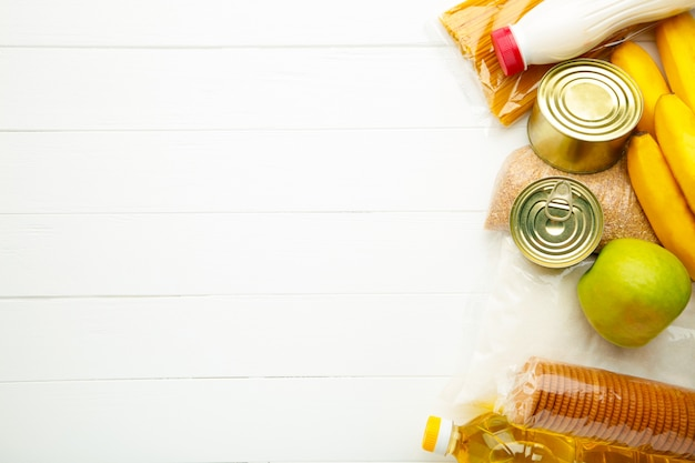 Food donations on the white background. top view