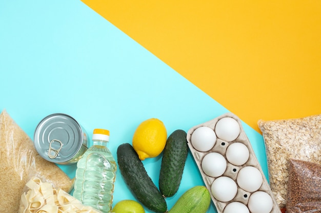 Food donations on yellow wall, top view