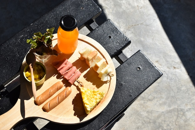 Food and drink concept, breakfast on wooden table - image