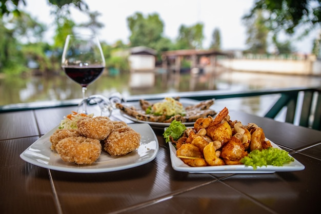Food and drinks on the table in the waterfront restaurant