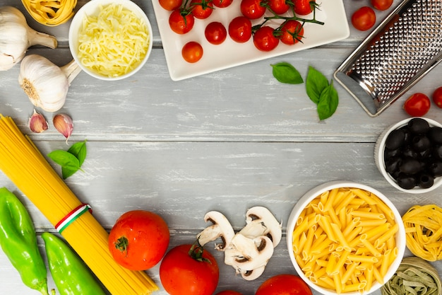 Food frame with pasta and tomatoes