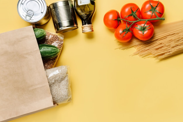 Food frame with products isolated on a yellow wall.