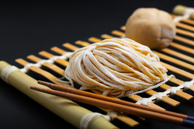 Food fresh raw homemade oriental asian, chinese egg noodles