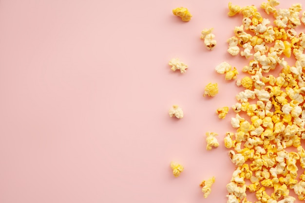 Food. frozen popcorn corn delicious yellow popcorn on pink. cinema. copyspace. place for text.