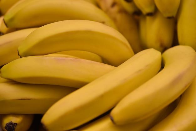 Food fruit fresh yellow bananas background. fresh bananas pattern for sale in market