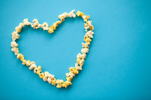 Food. image of the heart forms from popcorn. delicious popcorn. cinema