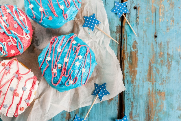 Food for independence day. 4th of july. festive breakfast: traditional american donuts with glaze in colors of usa flag