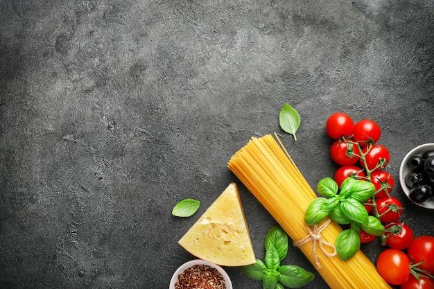 Food ingredients for italian pasta on black.