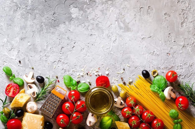 Food ingredients for italian pasta, spaghetti on grey concrete background.