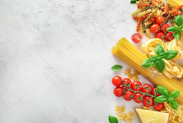 Food ingredients for italian pasta on white