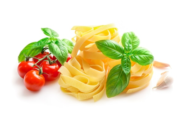 Food ingredients for italian pasta on white.
