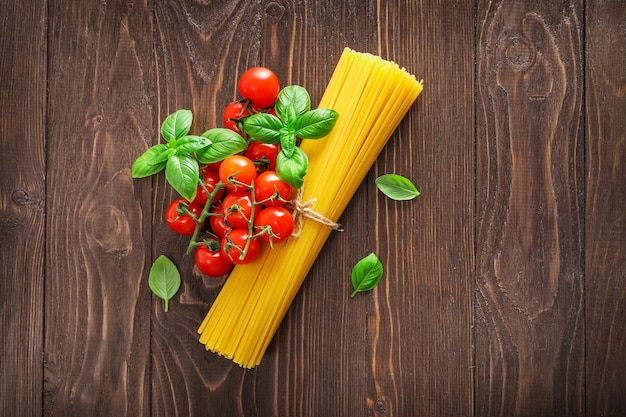 Food ingredients for italian pasta on wooden.