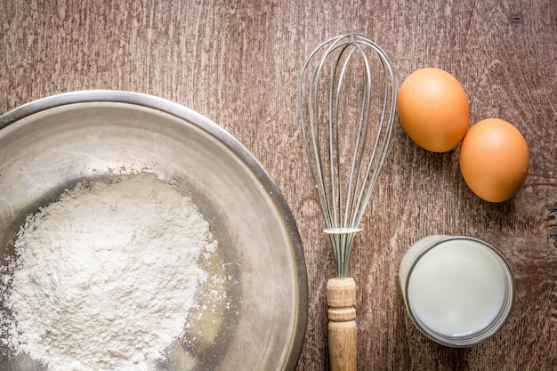 Food ingredients and kitchen utensils for cooking on wooden background. top view. copy space. still life. flat lay