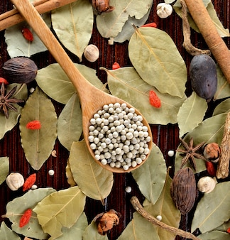 Food ingredients - peppercorns herbs and spices.