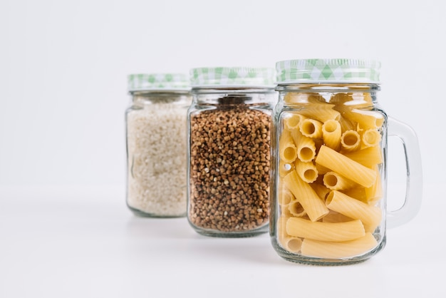 Food in jars on white background