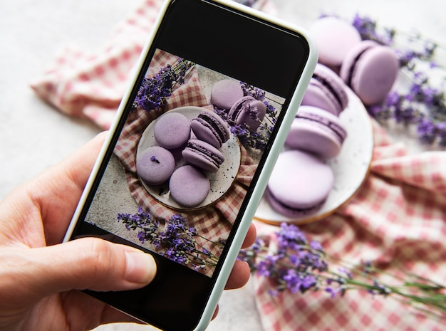 Food photography concept. photo of french desserts macaroon with lavender taken on a smartphone