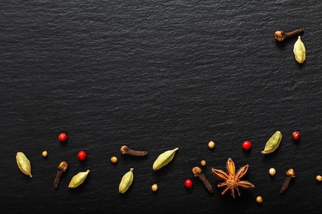 Food presentation background organic various exotic species on black slate board