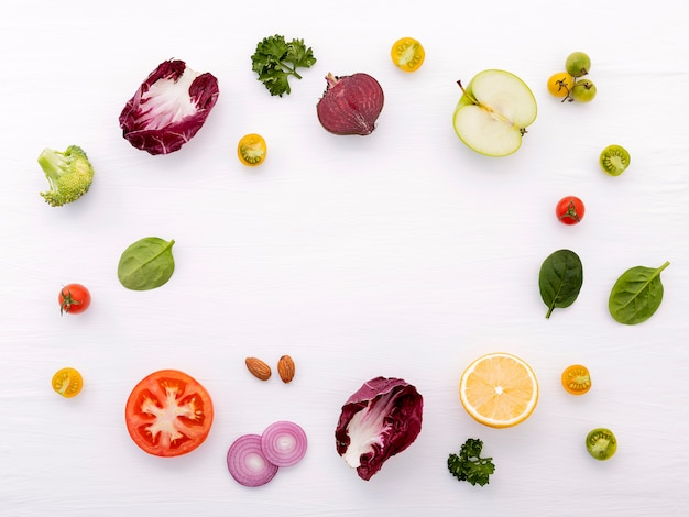 Food and salad concept with raw ingredients  flat lay on white wooden.