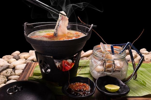 Food served in a pot japan where the sea food shabu-shabu
