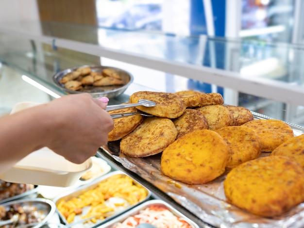 Food store, serving spanish potato omelette