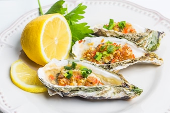 Food stuffed oysters and red pepper with lemon