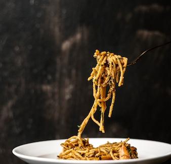 Food styling spaghetti plate closeup