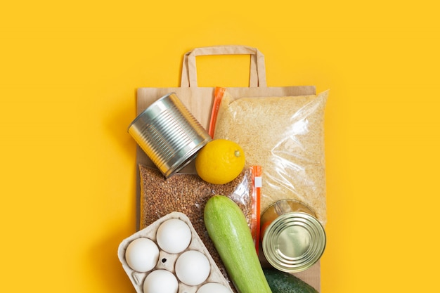 Food supplies on paper bag. donation, food delivery.