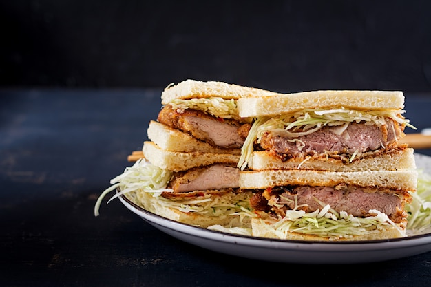 Food trend japanese sandwich with breaded pork chop