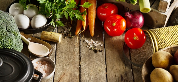 Food vegetable colorful background. tasty fresh vegetables on wooden table. top view with copy space.