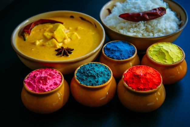 Food with colours, steam rice, panir butter masala, pepper chili, star anise and powder colours