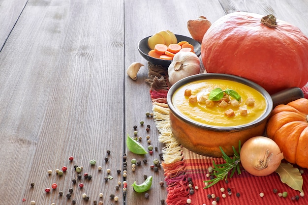 Food with pumpkin soup with ingredients