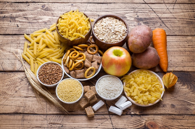Foods high in carbohydrate on rustic wooden table