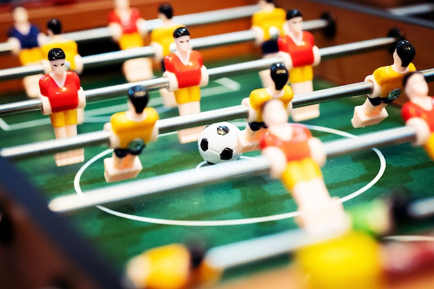 Foosball table soccer. football player, sport concept