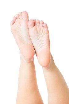 フットケア。孤立した美しい女性の脚。