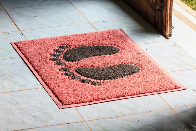 Foot on floor mat with
