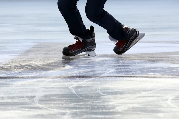 Foot ice-skating person on the ice rink
