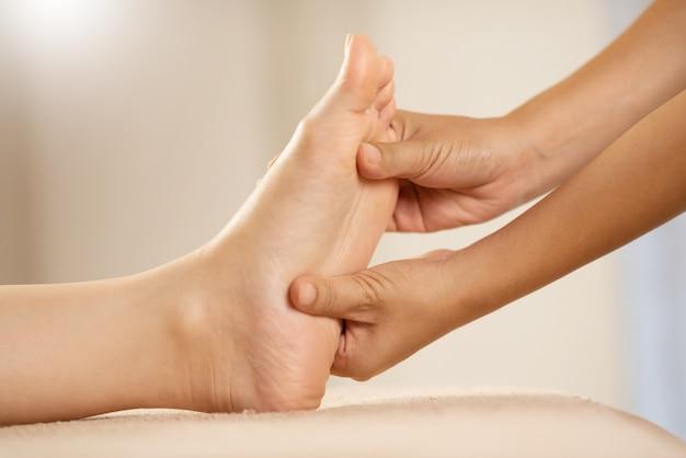 Foot massage at the spa salon.