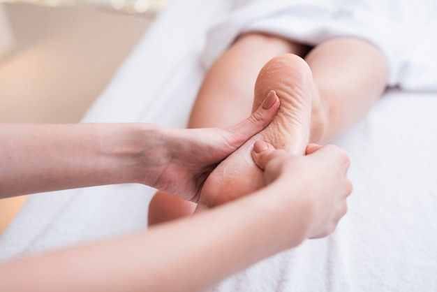 Foot massage therapy at spa